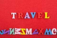 TRAVEL word on red background composed from colorful abc alphabet block wooden letters, copy space for ad text. Learning. Word on red background composed from stock photography