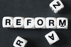 Word reform on toy cubes. Word reform on white toy cubes Stock Image