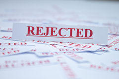 The word rejected. The word rejected surrounded by some shredded papers Stock Photos