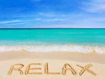 Word Relax on beach. Vacation concept background stock images