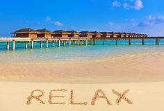 Word Relax on beach. Nature holiday background Royalty Free Stock Image