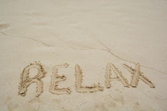 Word Relax on beach Stock Photo