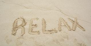 Word Relax on beach. Stock Image