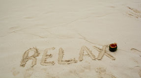 Word Relax on beach. Stock Photo