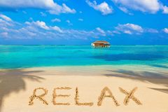 Word Relax on beach. Nature holiday background stock photos