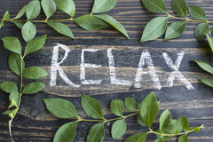 Word Relax with Leaves. On Rustic Wooden Background royalty free stock photo