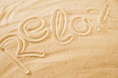 Word Relax on sand beach. Concept background idea stock photo