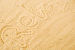 Word Relax on sand beach. Concept background idea royalty free stock image