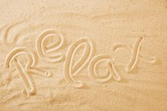 Word Relax on sand beach. Concept background idea stock images
