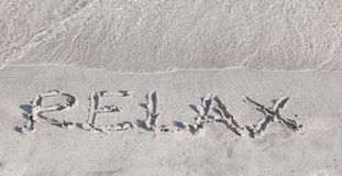 Word Relax on the sand Royalty Free Stock Images