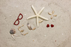 The word RELAX on sandy beach with red hearts Royalty Free Stock Photos