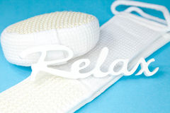 Word relax on sponge and scrubber - Stock Photo Royalty Free Stock Photos