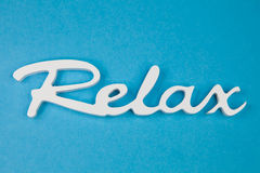 Word relax - Stock Photo. Word relax in white on a turquoise background - Stock Photo Royalty Free Stock Photos