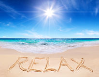 Word relax on the tropical beach. Composition of the word relax written on the tropical beach royalty free stock image