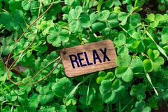 The word relax wooden tag. On Clover stock images