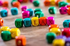 Word Relax Word In Wooden Cube. Relax Word In Wooden Cube. close up royalty free stock photography