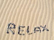 Word relax written in sand. On a sunny day stock photo