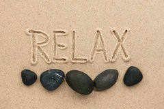 Word  relax  written on the sand Royalty Free Stock Images