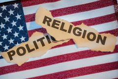 The word religion laying over the word politics on an American F Stock Images