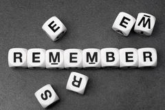 Word remamber on toy cubes. Word remember on white toy cubes Royalty Free Stock Photos