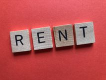 The word Rent, in a banner form on red stock photography