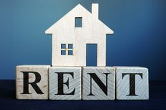 Word Rent from cubes and model of home. Real estate stock photos