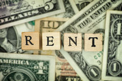 Word RENT on dollar bills Royalty Free Stock Images