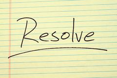 Resolve On A Yellow Legal Pad. The word `Resolve` underlined on a yellow legal pad Stock Images