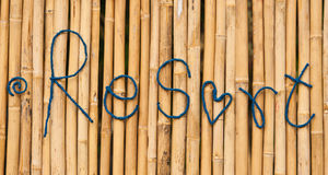 Word resort made of rope on the bamboo Royalty Free Stock Image