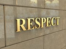 Word Respect. The word Respect is chiseled by gold letters on a stone wall Royalty Free Stock Images