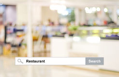 Word Restaurant written on search bar over blur restaurant backg Royalty Free Stock Image