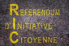 Word RIC meaning referendum at citizen`s initiative on asphalt. Background stock photography