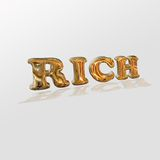 Word rich. On a light background there is a word elite, written by the chrome plated letters Stock Image