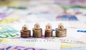 Word Risk on coin stacks, cash background Stock Images