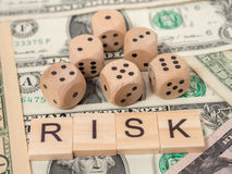 Word RISK in wooden block and dices Stock Photography
