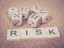 Word RISK in wooden block and dices Royalty Free Stock Photography