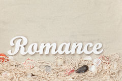 Word Romance and net with shells Royalty Free Stock Photography