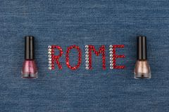 Word Rome, made of rhinestones, encrusted on denim. World Fashion. Stock Images