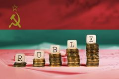 Word RUBLE composed of wooden letters. Transnistrian flag as a background. Closeup stock photography
