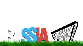 Word russia and soccer ball in the gate on the grass. Stock Photos