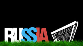 Word russia and soccer ball in the gate on the grass. Royalty Free Stock Photography