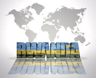 Word Rwanda on a world map background. Word Rwanda with Rwandan Flag on a world map background Stock Images