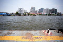 The word SAFETY FIRST on yellow line. On pier Royalty Free Stock Image