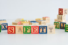 """The word """"safety"""" spelled with wooden letter cubes Stock Photography"""