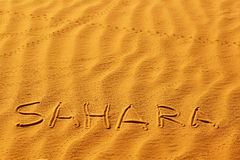 Word Sahara written on the sand Royalty Free Stock Photography