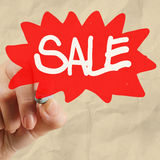 Word sale with crumpled paper Stock Photos