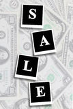Word sale on the dollars background Royalty Free Stock Photo