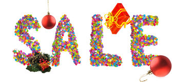 Word sale formed of colorful confetti with christmas decorations. Royalty Free Stock Photography