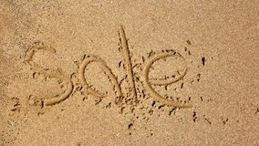 Word sale handwritten in sand Stock Photo