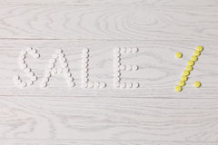 Word Sale made of pills on table Royalty Free Stock Photos
